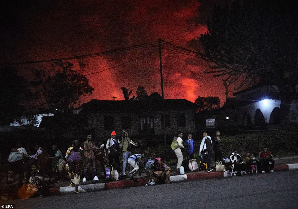 Volcano erupts in the Congo spewing red fumes into the night sky